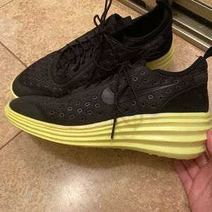 black nike shoes with a lime green wedge